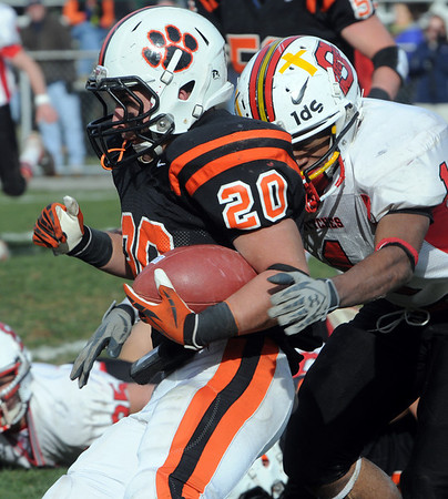 Beverly:<br /> Beverly's Nick Theriault gets tackled by Salem's Dwayne Satterwhite during the Salem at Beverly football game at Hurd Stadium.<br /> Photo by Ken Yuszkus/Salem News, Thursday, November 25, 2010.