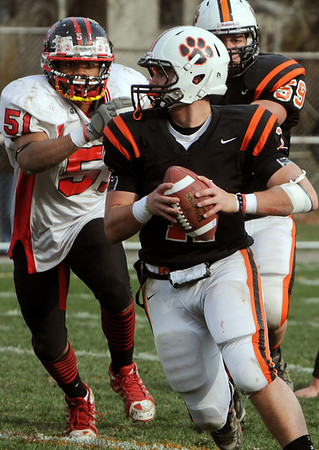 Beverly:<br /> Beverly's Joe Wioncek looks for a receiver during the Salem at Beverly football game at Hurd Stadium.<br /> Photo by Ken Yuszkus/Salem News, Thursday, November 25, 2010.