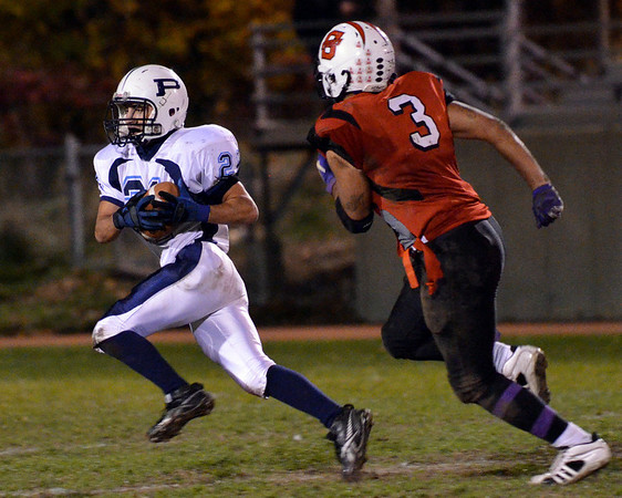Salem: Peabody's Brady Doyle, left, carries the ball followed Salem's Antonio Reyes.  photo by Mark Teiwes / Salem News