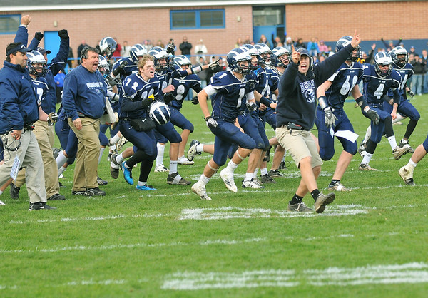 Swampscott: Swampscott celebrates their 21-20 win over Marblehead.  photo by Mark Teiwes / Salem News