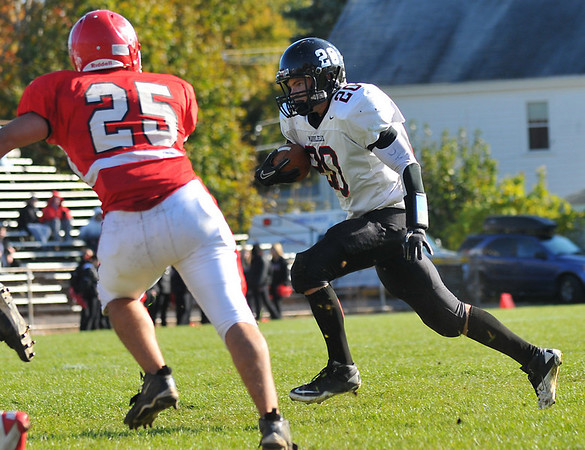 Saugus:  Marblehead's Will Quigley carries the ball during the team's 23-16 win on Saturday over Saugus.   photo by Mark Teiwes / Salem News