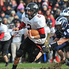 Swampscott: Marblehead's Ryan Stanojev carries the ball past Swampscott's Mark Lausier.  photo by Mark Teiwes / Salem News