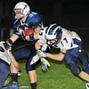 Peabody:Peabody's DJ Henrick rolls off of Swampscott's  Richard Sullivan, right, gaining yardage.    photo by Mark Teiwes / Salem News