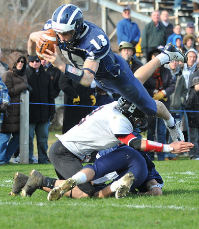 Swampscott: Swampscott quarterback Michael Walsh dives into the end-zone over Marblehead's Ryan Stanojev scoring the team's first touchdown beginning Swampscott's 21-20 come-back win.  photo by Mark Teiwes / Salem News