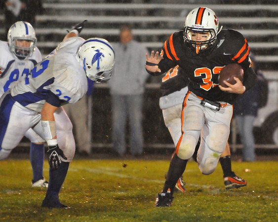 Beverly: Beverly's Brendan Flaherty, right, cuts across the field follow by Danvers defenseman Tyler Dora.  photo by Mark Teiwes / Salem News