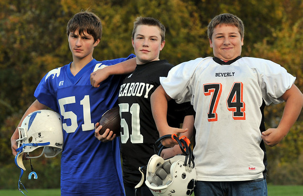 Danvers: Three 12-year-old cousins with the same last name, Shairs, all play youth football on different teams, Jake, left, for Danvers, Kolbi for Peabody, and Nicholas for Beverly.    photo by Mark Teiwes / Salem News
