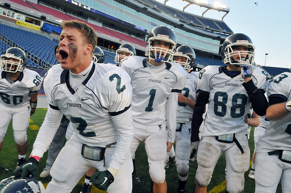 Foxborough: Pingree's Robert Adam, left, cheers as his team scores a touchdown coming back to tie the game late in the fourth quarter. photo by Mark Teiwes / Salem News