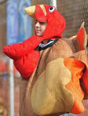 Peabody: Stephen Girolamo, Peabody High School junior, helped collect money for Haven for Hunger at the Thanksgiving Day football game.    photo by Mark Teiwes / Salem News
