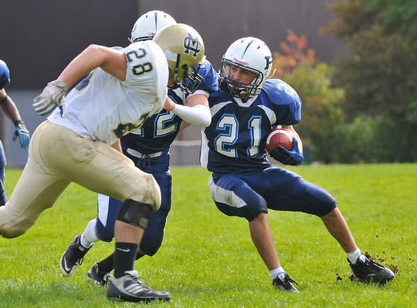 Peabody running back Brady Doyle, right, cuts into open space with a lead block by teammate Kris Behsman.