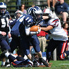 Swampscott: Swampscott High School football player Phillip Larkin eludes a tackle from Revere's Frank Melito, right.  Larkin scored a game winning two-point conversion at the end of the game.
