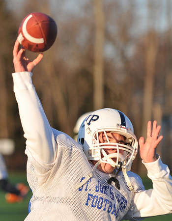 Danvers; St. John's Prep football team practices in preparation for Saturday's Superbowl: quarterback Tommy Gaudet.   photo by Mark Teiwes / Salem News