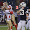 Foxboro:<br /> St. John's Prep's Blair Friedensohn, right, walks off the field while Everett celebrates in the background, after St. John's Prep lost the St. John's Prep vs Everett High School in the Division 1 Super Bowl football game at Gillette Stadium on Saturday. St. John's Prep lost.<br /> Photo by Ken Yuszkus/Salem News, Saturday, December 4, 2010.