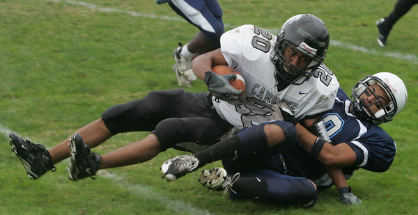 Peabody's Ramses Vittini brings down Cambridge's Zolan Kanno-Young during Friday afternoon's game held at Peabody Veteran's Memorial High School. Photo by Deborah Parker/September 17, 2010