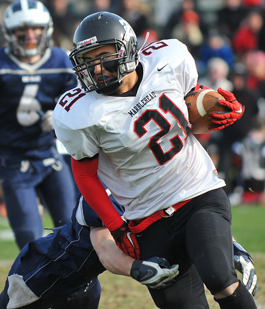 Swampscott: Marblehead's Oliver Kim rushes slowed down by a Swampscott defender.  photo by Mark Teiwes / Salem News