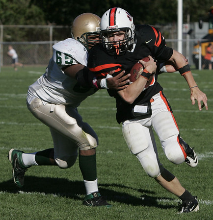 Beverly's  Kenny Pierce is defended by Lynn Classical's Armand Stephan during Saturday's game held at Hurd Stadium in Beverly. Photo by Deborah Parker/October 9, 2010