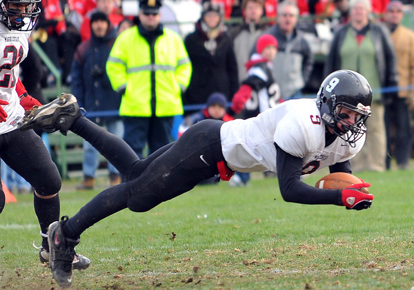 Swampscott: Marblehead's Colton Dana dives for a catch on Marblehead's last drive to a touchdown.  photo by Mark Teiwes / Salem News