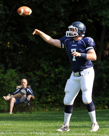 Hamilton: Pingree quarterback Brendan Oliver makes a pass in the first half.  photo by Mark Teiwes / Salem News