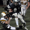 Reading:<br /> Hamilton-Wenham's Dylan Keith takes the ball down field along with a tackler at the Hamilton-Wenham vs Cardinal Spellman state football playoff semi-final Division 3A game at Reading High School field.<br /> Photo by Ken Yuszkus/Salem News, Tuesday November 30, 2010.