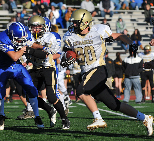 Peabody: Bishop Fenwick's Ryan Lipka runs after making a catch during a game against Georgetown.  Bishop Fenwick lost 14-25.   photo by Mark Teiwes / Salem News