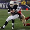 Foxboro:<br /> St. John's Prep's Tommy Gaudet gets squeezed by an Everett player at the St. John's Prep vs Everett High School in the Division 1 Super Bowl football game at Gillette Stadium on Saturday.<br /> Photo by Ken Yuszkus/Salem News, Saturday, December 4, 2010.