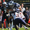 Swampscott: Big Blue player Zach Beermann gets held up by Revere defenseman Jose Amaya.  Beerman scored Swampscott's first touchdown in the second quarter beginning their comeback.
