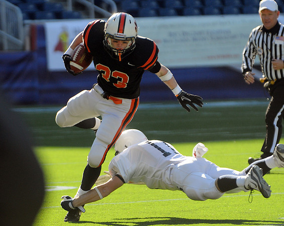 Beverly's Brendan Flaherty gets tackled by a Somerset defender during the Division 3 Super Bowl at Gillette Stadium on Saturday.<br /> Photo by Ken Yuszkus/Salem News, Saturday, December 4, 2010.