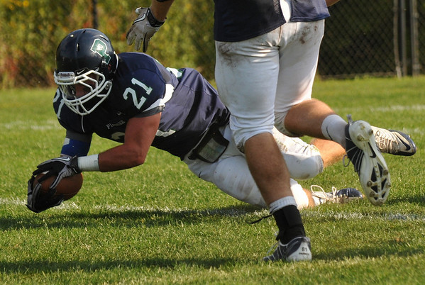 Hamilton: Pingree's Will Walfield dives into the end zone for a touch down during a game against Holderness.  photo by Mark Teiwes / Salem News