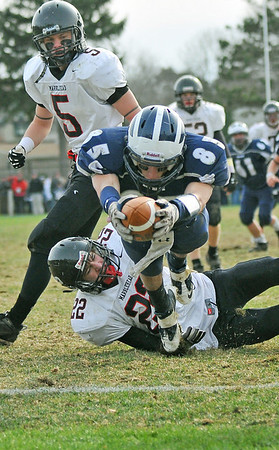 Swampscott: Swampscott's Zach Beermann dives to score a touchdown during the Thanksgiving game.  photo by Mark Teiwes / Salem News