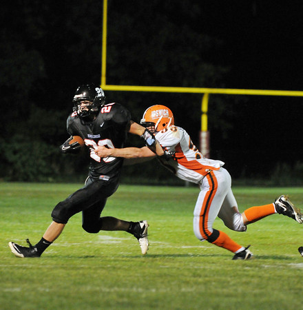 Marblehead: Marblehead High School football running back Will Quigley, left, makes a run as Ipswich player John Eldredge reaches for the tackle.   photo by Mark Teiwes / Salem News