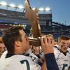 Foxborough: Pingree quarterback Brendan Oliver kisses the Norm Walker Bowl trophy after the triumph over Rivers. photo by Mark Teiwes / Salem News