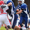 Peabody: Peabody's Brady Doyle, right, gains yards with a lead block from captain Chris Greene during the team's Thanksgiving Day 34-13 win over Saugus.  photo by Mark Teiwes / Salem News