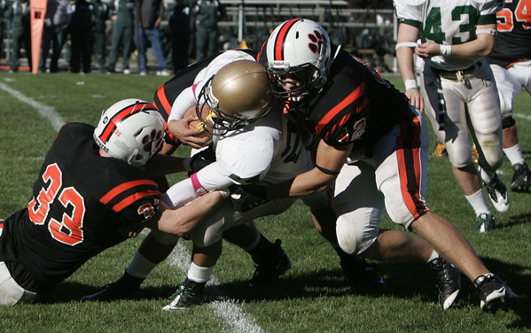 Lynn Classical's Sam Rios is brought down by Beverly's Brendan Flaherty and Anthony MacDonald during Saturday's game held at Hurd Stadium in Beverly. Photo by Deborah Parker/October 9, 2010