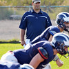 Swamscott: Swampscott High School varsity football head coach Steve Dembowski watches as his team runs drills during practice.  photo by Mark Teiwes / Salem News