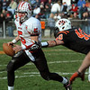 Beverly:<br /> Salem's Brad Skeffington runs to get away from Beverly's Mark Giles while  looking for a receiver during the Salem at Beverly football game at Hurd Stadium.<br /> Photo by Ken Yuszkus/Salem News, Thursday, November 25, 2010.