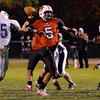 Salem: Surrounded by Peabody defenders Salem quarterback Brad Skeffington stays focused to make a touchdown pass deep in the endzone at the end of the first half. photo by Mark Teiwes / Salem News