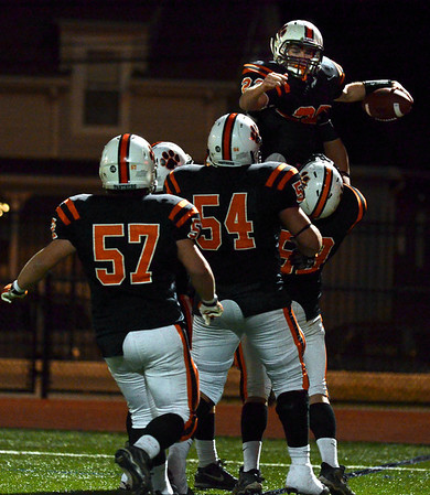 Lynn:  Beverly's Blake Sullivan is hoisted by teammates after he scored the team's touchdown fifth touchdown in the third quarter . photo by Mark Teiwes / Salem News