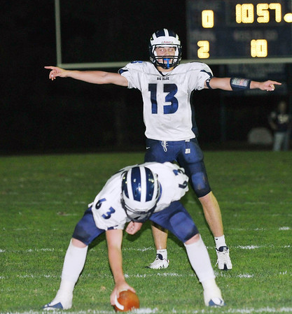 Peabody: Swampscott High School quarterback Michael Walsh sets up a play close to the end zone. photo by Mark Teiwes / Salem News