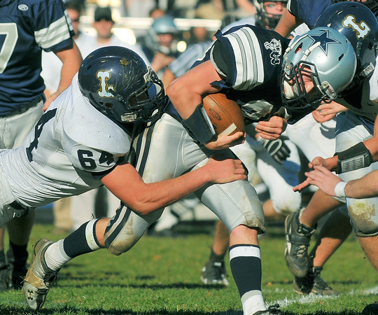 Hamilton: Hamilton-Wenham's Zach Nekorowski grits his teeth rushing into pressure from the Lynnfield defense. photo by Mark Teiwes / Salem News