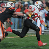 Beverly:<br /> Beverly's Mark Giles reaches for Salem's Chris Bozarjian during the Salem at Beverly football game at Hurd Stadium.<br /> Photo by Ken Yuszkus/Salem News, Thursday, November 25, 2010.