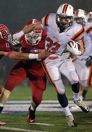 Beverly senior running back Brendan Flaherty carves his way through the Burlington defense on Tuesday evening. Flaherty led the way for the Panthers, rushing for 251 yards and 4 TD's, and propelled Beverly into the D2A Super Bowl with a 34-21 victory over the Red Devils on Tuesday evening. David Le/Staff Photo