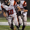 Beverly senior running back Kenny Pierce, right, looks for running room as teammate Zach Duguid, blocks out in front. David Le/Staff Photo