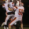 Beverly senior running back Brendan Flaherty, center, gets mobbed by teammates Ryan Shipp, left, Zach Duguid, and Kasey DiPaolo, right, after scoring a long first quarter touchdown for the Panthers. Flaherty would add three additional touchdown runs, leading Beverly to their 2nd D2 Super Bowl appearance in 3 years, and defeating host Burlington 34-21 on Tuesday evening. David Le/Staff Photo