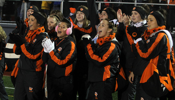 The Beverly Panther Cheerleaders applaud the football team as they come off the field following Beverly's 34-21 victory over Burlington in the Eastern Mass D2A semi-final at Varsity Field in Burlington on Tuesday evening. David Le/Staff Photo