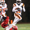 Beverly junior Sam Mulumba looks for running room while returning a kickoff against Burlington on Tuesday evening in the Eastern Mass D2A semi-final. David Le/Staff Photo
