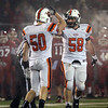 Beverly senior Brian Perry, right, salutes teammate junior Zach Duguid, left, after Duguid brought down Burlington quarterback Shane Farley for a sack on Tuesday evening in the Eastern Mass D2A final at Varsity Field in Burlington. David Le/Staff Photo