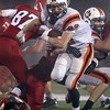 Beverly senior captain Brendan Flaherty breaks free from two Burlington defenders and rushes forward for a big gain on Tuesday night. Burlington couldn't find a way to contain Flaherty as he rushed for 251 yards and 4 TD's to lead the Panthers to a 34-21 victory over the Red Devils in the Eastern Mass D2A semi-final. David Le/Staff Photo