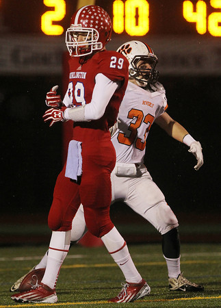 Beverly senior captain Brendan Flaherty screams in celebration after scoring a 38 yard touchdown, as Burlington senior Harrison Smoske, left, can only walk away in dejection. The Panthers defeated the Red Devils 34-21 in the D2A semi-final and advance to the Super Bowl. David Le/Staff Photo