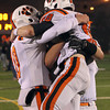 Beverly High School senior captains Dave Rollins, Kenny Pierce, and Marc Babcock embrace following the Panthers 34-21 victory over Burlington in the Eastern Massachusetts D2A semi-final at Varsity Field in Burlington on Tuesday evening. David Le/Staff Photo