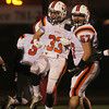 Beverly senior running back Brendan Flaherty, left, celebrates his first quarter long touchdown run with senior captain Marc Babcock, right, on Tuesday evening. Flaherty and the Panthers advanced to the Eastern Mass D2A Super Bowl with a 34-21 victory over Burlington at Varsity Field in Burlington. David Le/Staff Photo