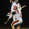 Beverly senior running back Kenny Pierce jumps into the arms of senior offensive lineman Mike Dooling, after Pierce scored a touchdown to open up the Panthers lead over the Burlington Red Devils. Pierce and the Panthers defeated Burlington in the Eastern Mass D2A semi-final to advance to the Super Bowl on Saturday at Gillette Stadium. David Le/Staff Photo